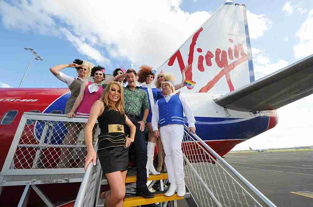 Crew and guests on board a Sydney bound Virgin flight on February 26, 2010 in Melbourne, Australia. In celebration of The Sydney Gay and Lesbian Mardi Gras, one of the biggest events on the Sydney calendar, Virgin Blue has dedicated an entire commercial flight from Melbourne to Sydney to the glitz and glamour of this annual event.
