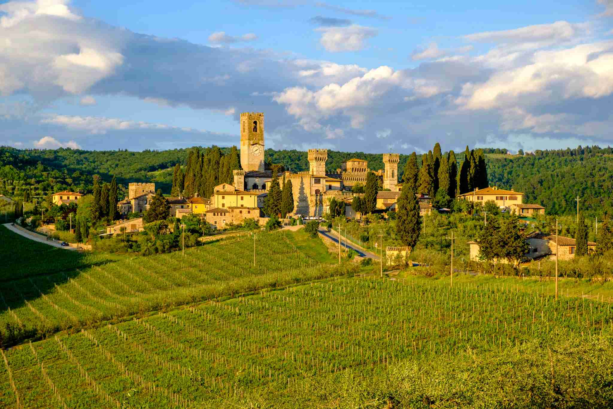BADIA A PASIGNANO, TUSCANY, ITALY - 2017/05/15: The stone houses of the small village and the Abbazia (Abbey), monastery, are located between large vineyards in Chianti. (Photo by Frank Bienewald/LightRocket via Getty Images)