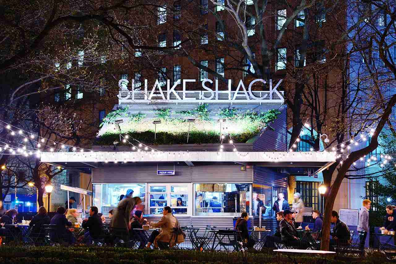 New York City, USA - April 15, 2013: Customers dine at Shake Shack in Madison Square Park. The chain diner opened in 2004 and the Madison Square Park location is the original.