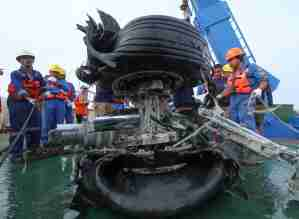 An Indonesian rescue team lift a pair tires from the ill-fated Lion Air flight JT 610 off Karawang in the Java Sea on November 4, 2018. - An Indonesian diver died while recovering body parts from the ill-fated Lion Air plane which crashed into the sea killing 189 people, an official said on November 3. (Photo by AZWAR IPANK / AFP) (Photo credit should read AZWAR IPANK/AFP/Getty Images)