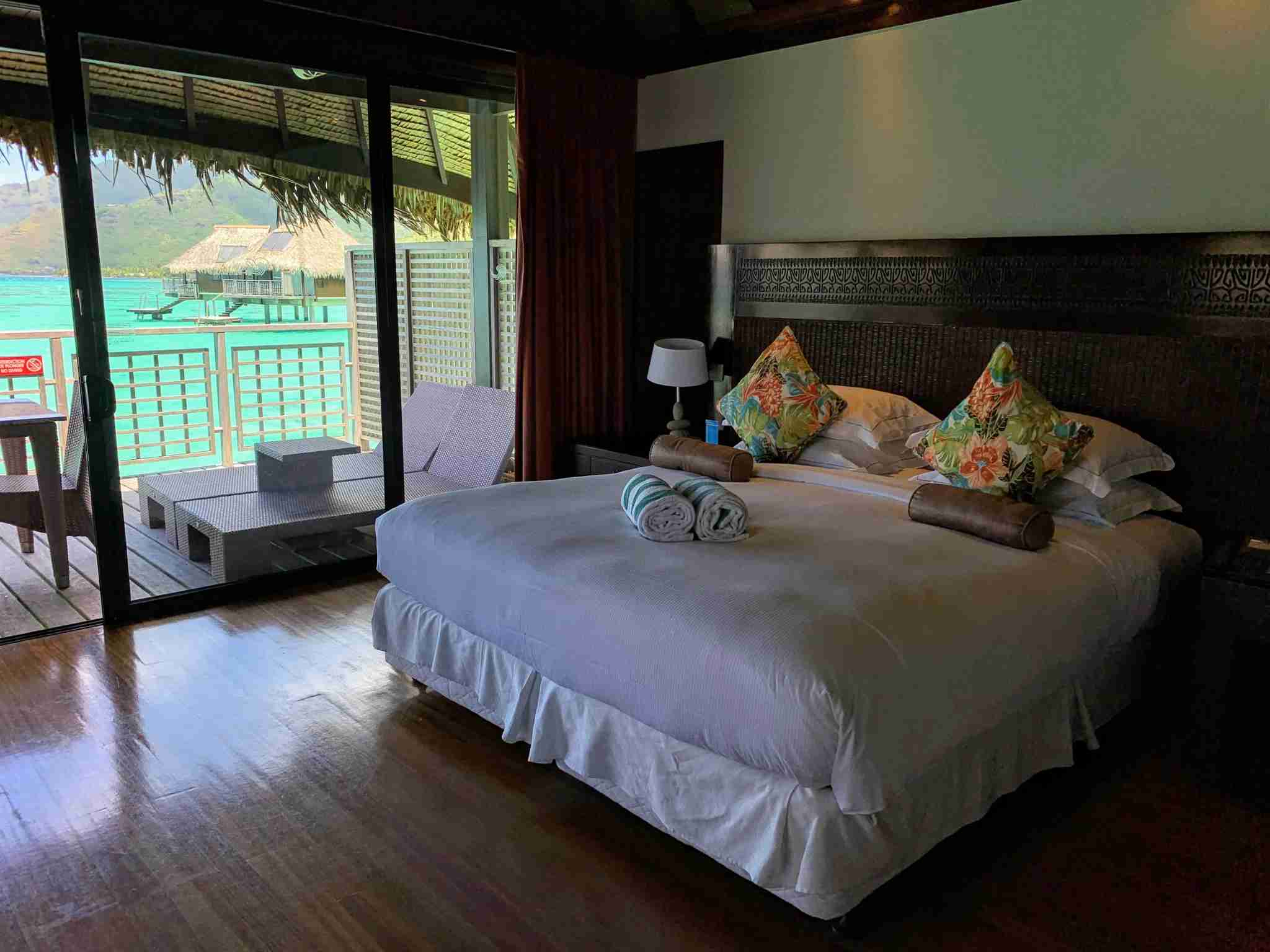 Hilton Moorea Lagoon Resort and Spa - overwater bungalow bed