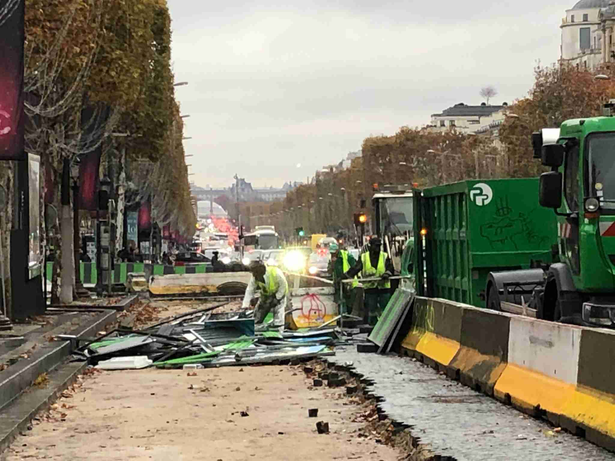 Debris and barricades are removed from the iconic Paris avenue (Image via Edward Pizazrello)