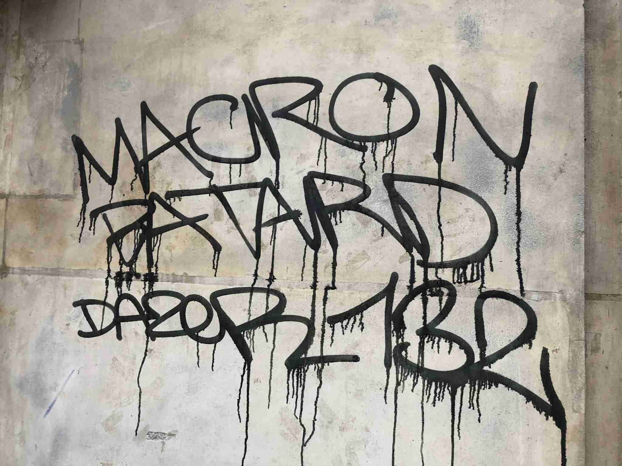 Anti-Macron graffiti in Paris following a day of violent demonstrations (Image via Edward Pizazrello)