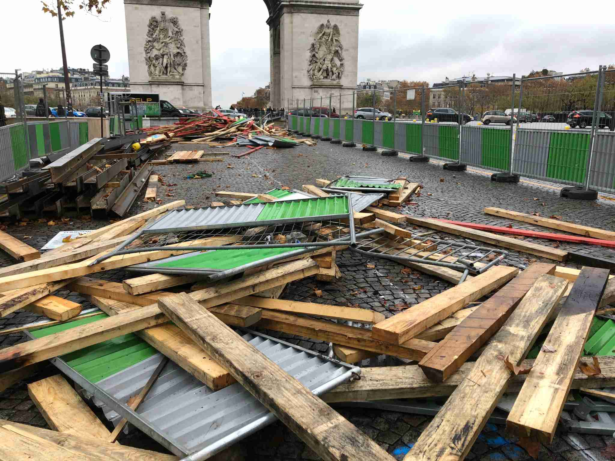 Barricades are cleaned up following a day of violent protests in Paris (Image via Edward Pizazrello)