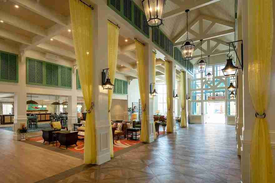 The Old Port Royale complex has been reimagined as a new port of entry for Disney's Caribbean Beach Resort. It's a centralized and convenient location for services, amenities and three new dining options. Guests arrive at Old Port Royale via an all-new porte-cochere, where they are welcomed into a colorfully reappointed lobby under an open-trussed roof and a colonnade with floor-to-ceiling drapes. Friendly cast members are waiting in this open and communal environment to help guests check in to their rooms, answer questions, offer advice to help them better enjoy their stays and more.