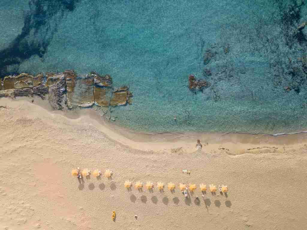 An aerial view of a beach in Crete, Greece. (Photo by Alexander Slash via Unsplash)
