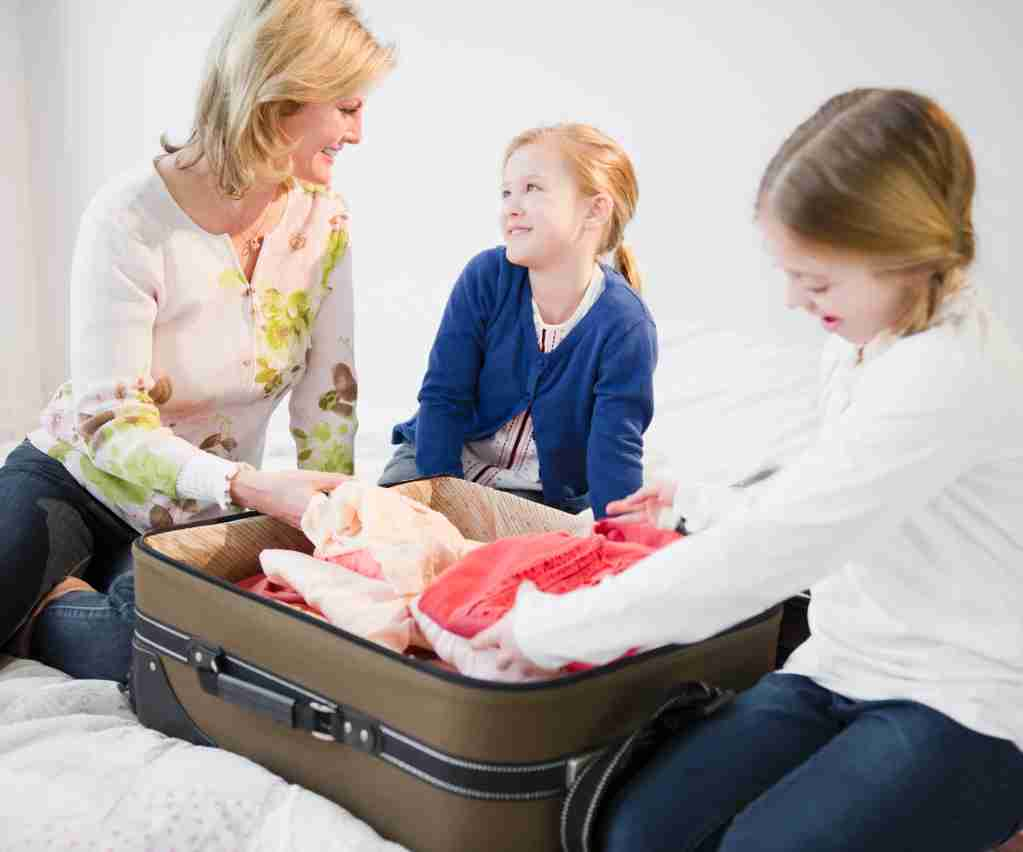children packing bag with mom