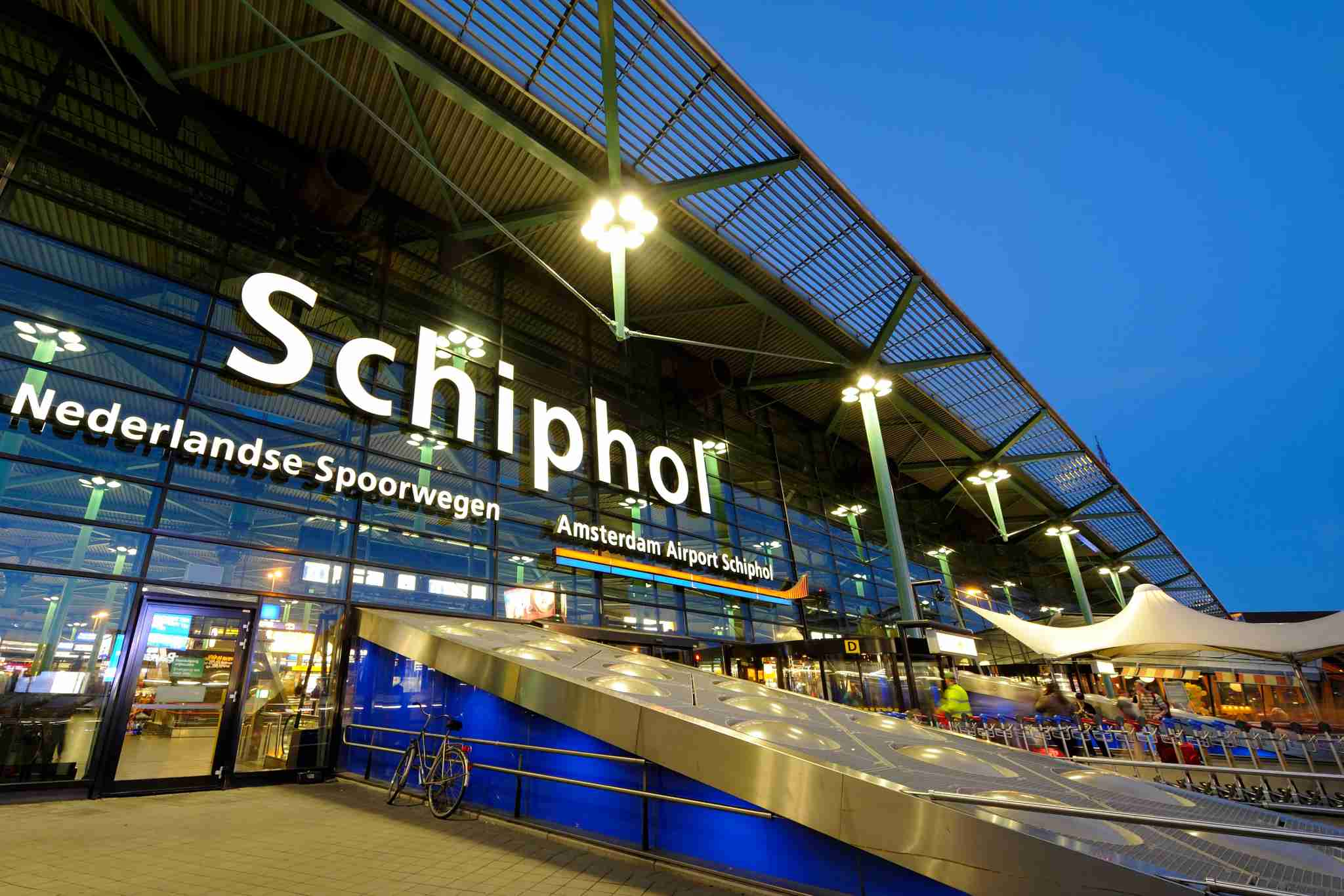 The entrance of Amsterdam Airport Schiphol in the evening. Schiphol is located 9 kilometers southwest of Amsterdam.