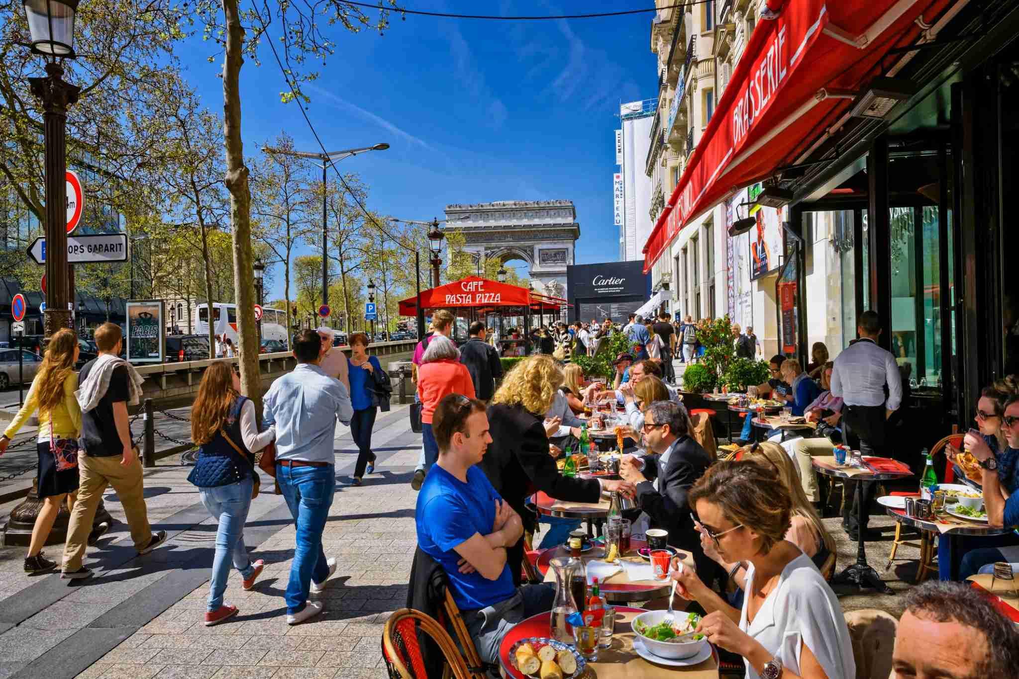 Cafe-Restaurant in Avenue des Champs Elysees. Arc de Triomphe, Paris, France