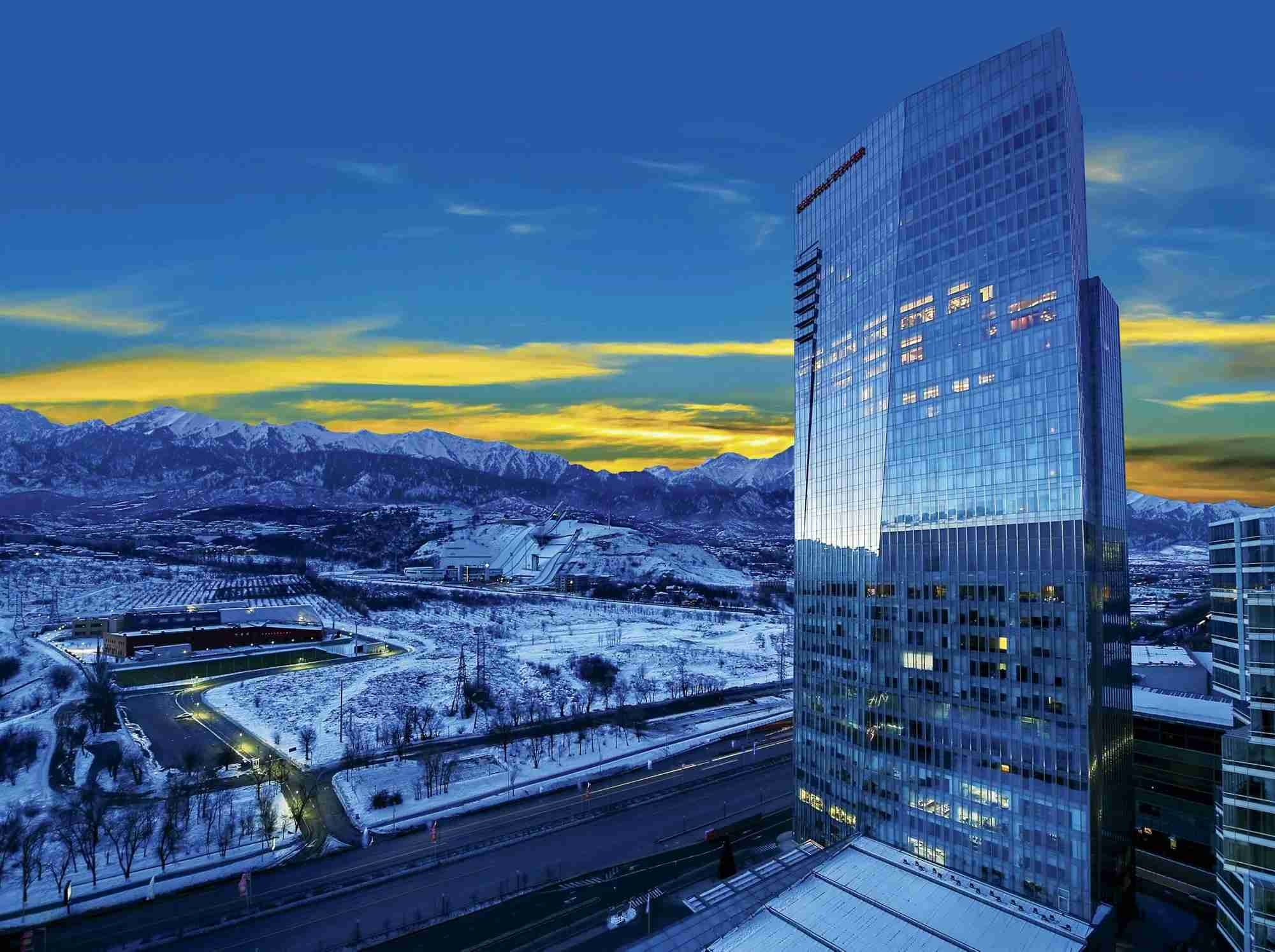 The Ritz Carlton Almaty, with the Tien Shan Mountains and the