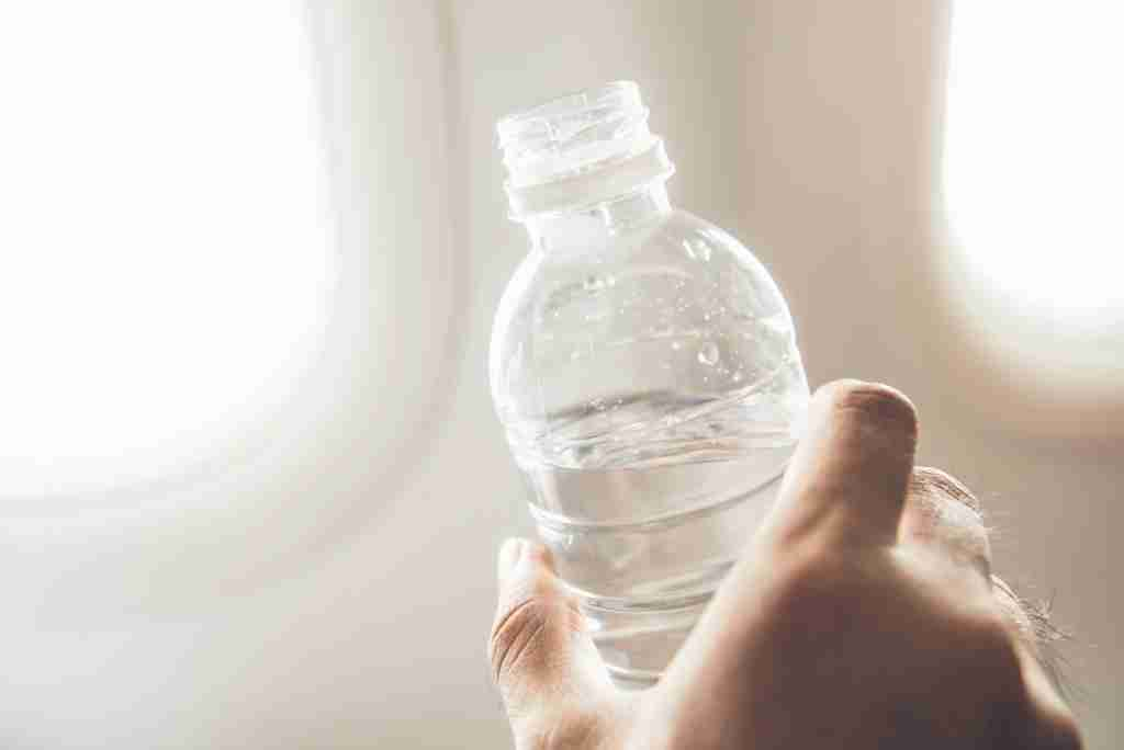 Hydration on long journeys is important, and drinking caffeine and alcohol will just get in the way. (Photo via Shutterstock)