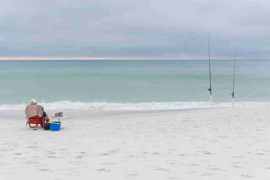Fishing on the white sand beach of Destin. (Photo via Getty Images)