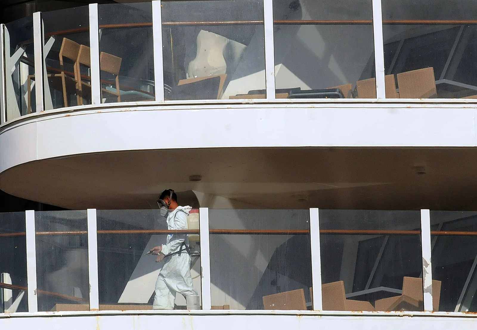 A Crew member on a cruise ship sprays disinfectant to sanitize the ship. (Photo by Paul Hennessy/NurPhoto via Getty Images)