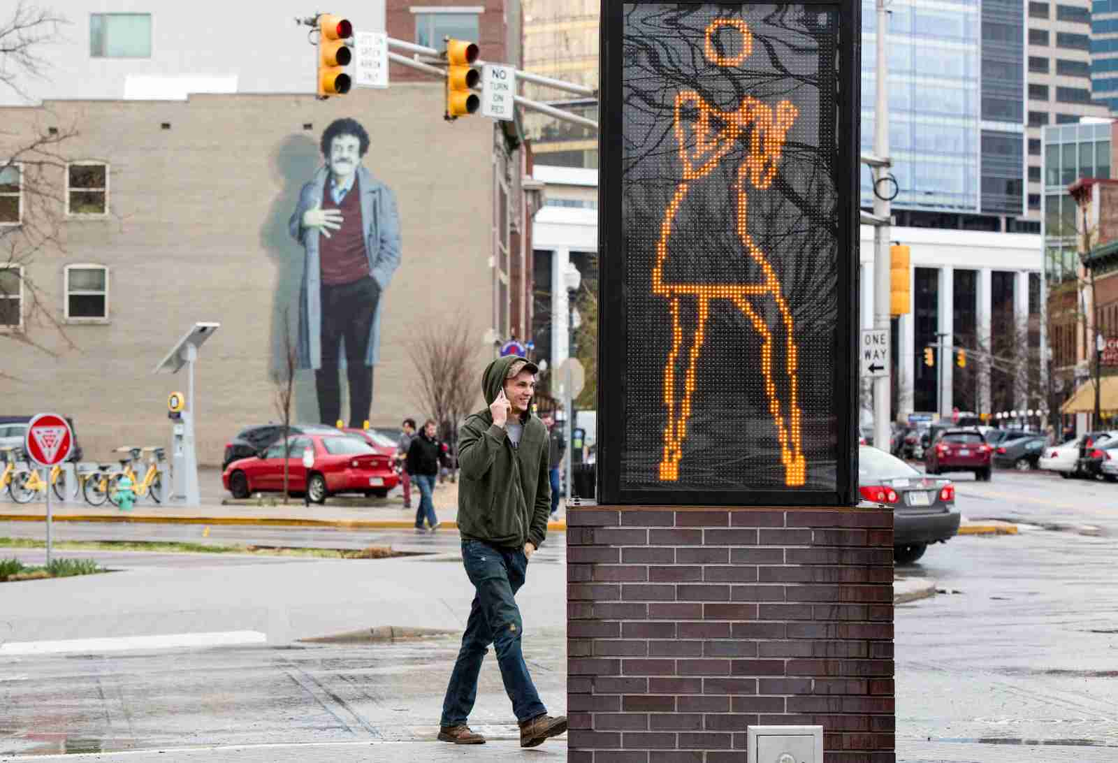"""In downtown Indianapolis, a Kurt Vonnegut mural sits behind """"Ann Dancing,"""" a LED light sculpture created in 2007 by Julian Opie. (Photo By Al Drago/CQ Roll Call)"""