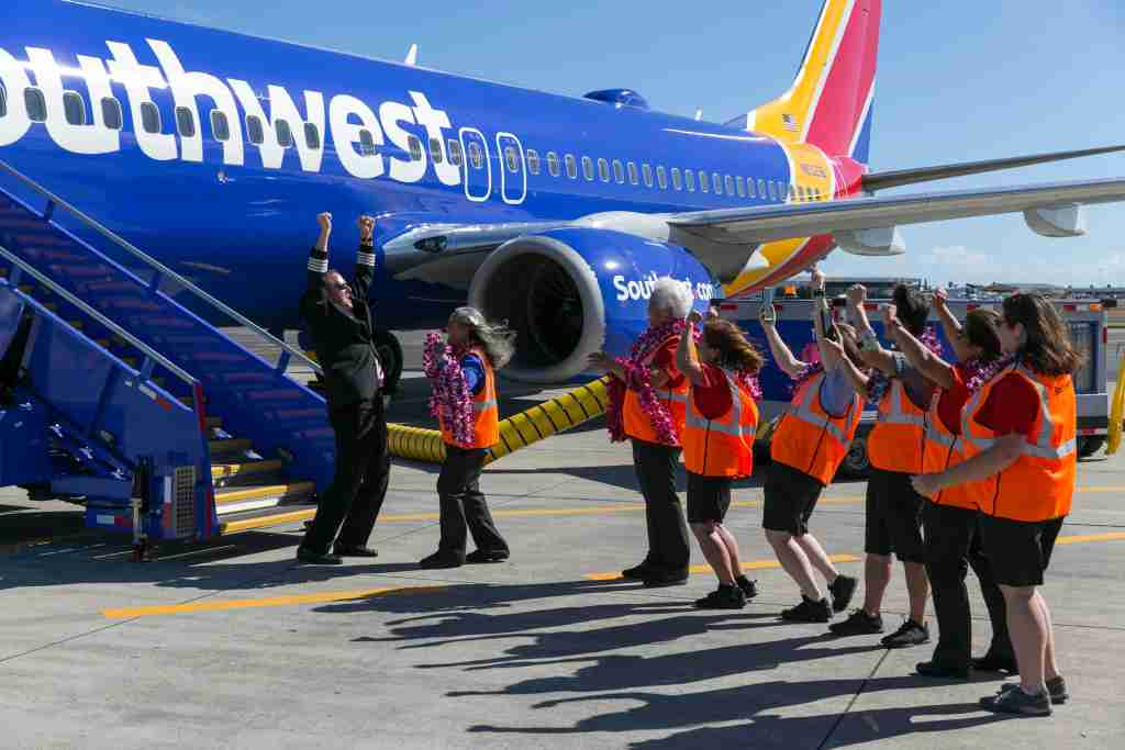 Southwest Airlines crew celebrate their inaugural flight to Hawaii at the Honolulu International Airport, Tuesday, February 5, 2019, in Honolulu. (Marco Garcia/The Points Guy)