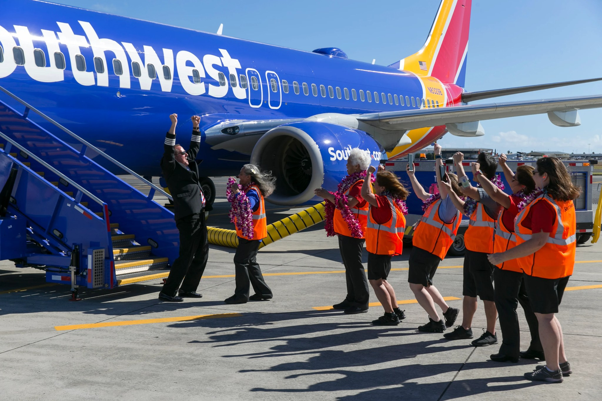 996fc8e764 Southwest Airlines crew celebrate their inaugural flight to Hawaii at the  Honolulu International Airport