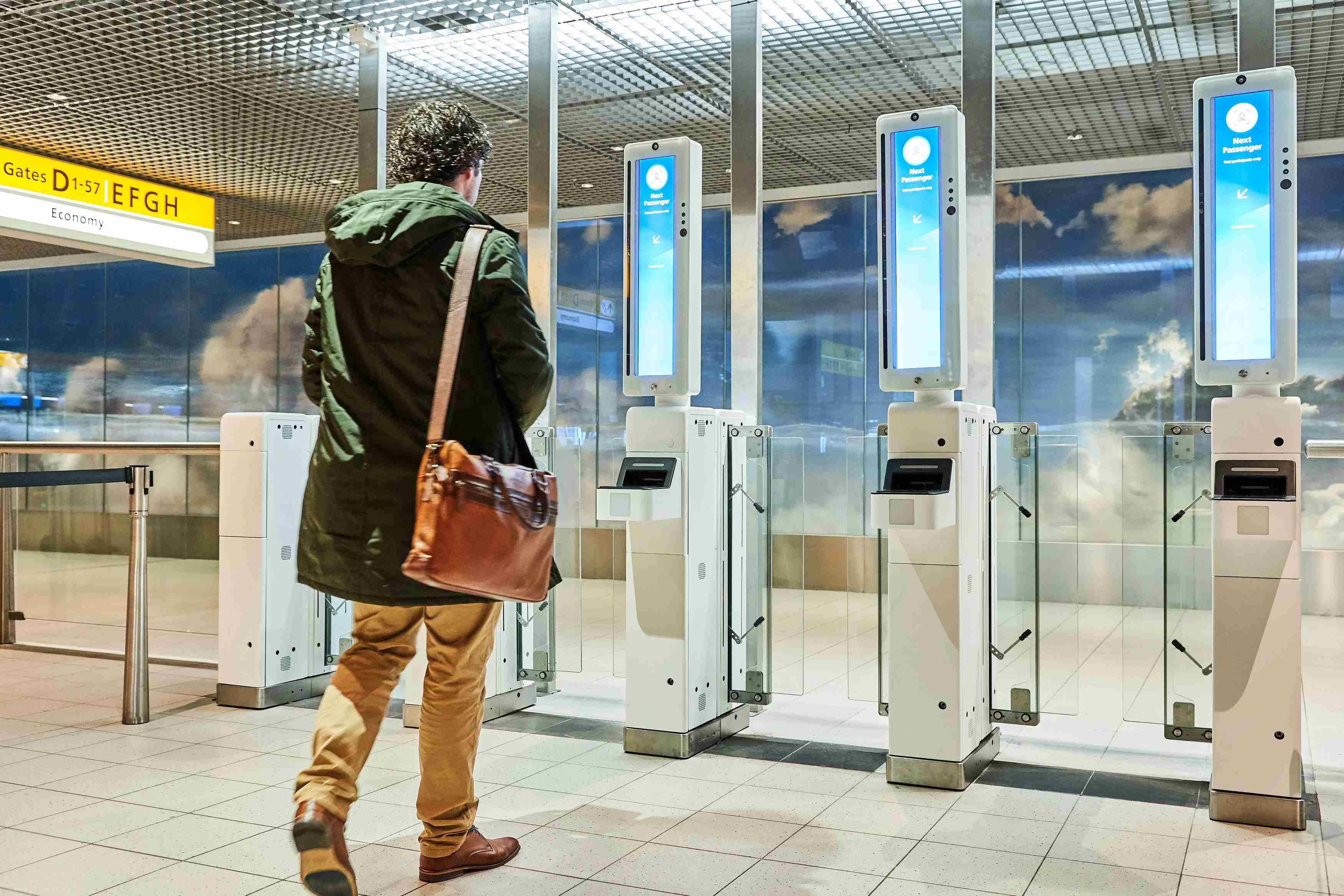 A passenger approaches a facial recognition gate at Amsterdam Airport Schiphol