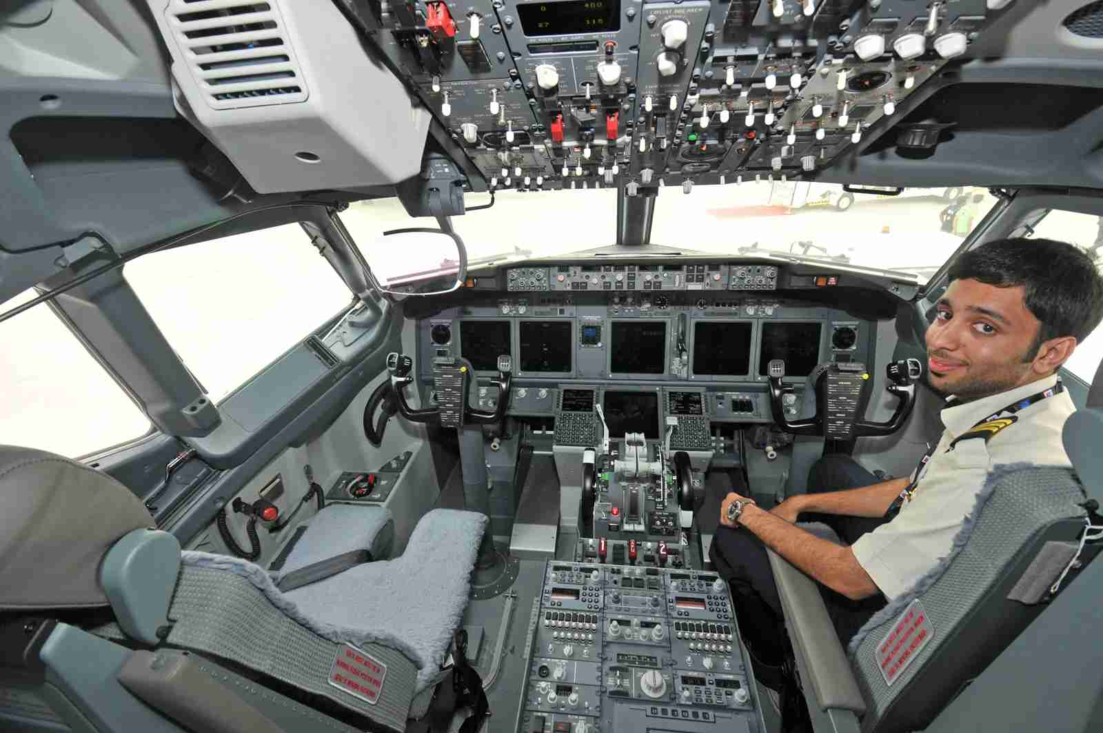 A young first officer with FlyDubai in the cockpit of a Boeing 737-800 (Photo by Alberto Riva/TPG)