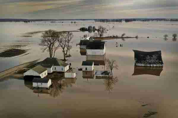 """CRAIG, MISSOURI - MARCH 22: Floodwater surrounds a farm on March 22, 2019 near Craig, Missouri. Midwest states are battling some of the worst floodings they have experienced in decades as rain and snowmelt from the recent """"bomb cyclone"""" has inundated rivers and streams. At least three deaths have been linked to the flooding. (Photo by Scott Olson/Getty Images)"""