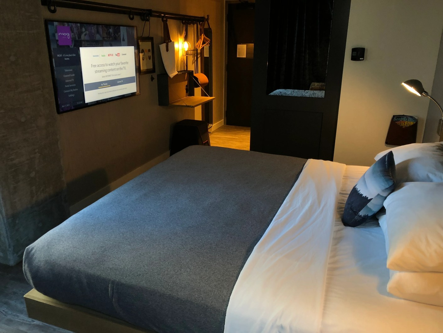 Overview of a standard king room at the Moxy Hotel Seattle
