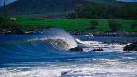 Waves crash in Molokai, Hawaii