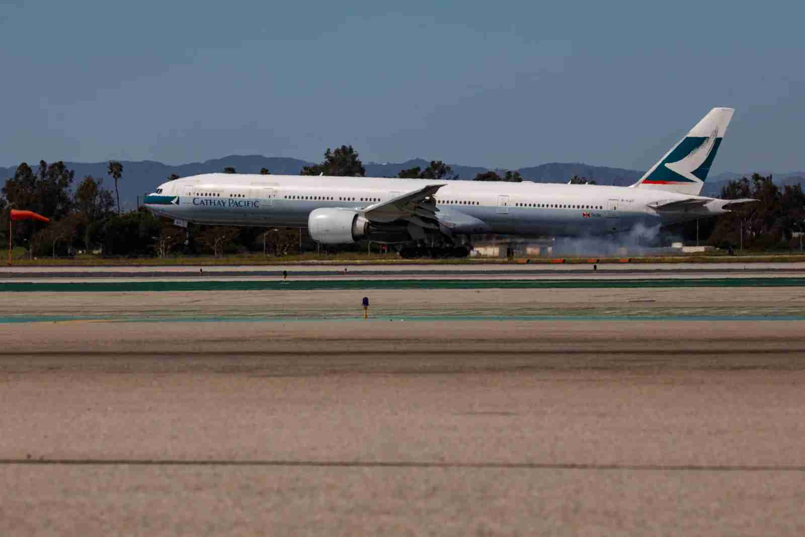 A Cathay Pacific Boeing 777-300ER lands at Los Angeles International Airport (LAX) on March 29, 2019. (Patrick T. Fallon for The Points Guy)