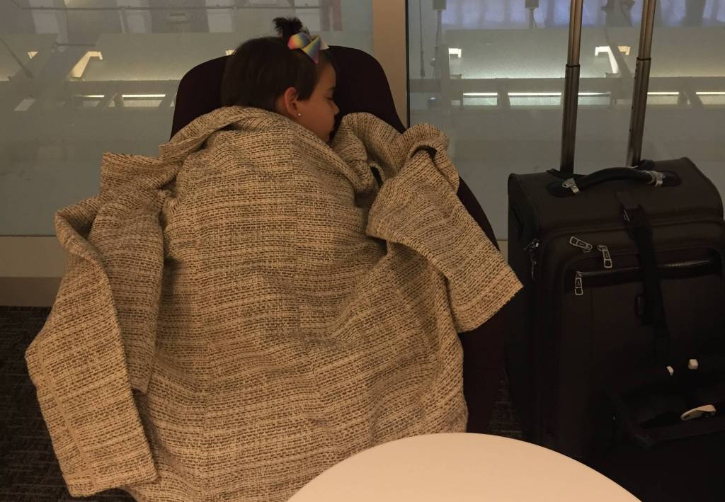 My daughter napping in the DFW Centurion Lounge.