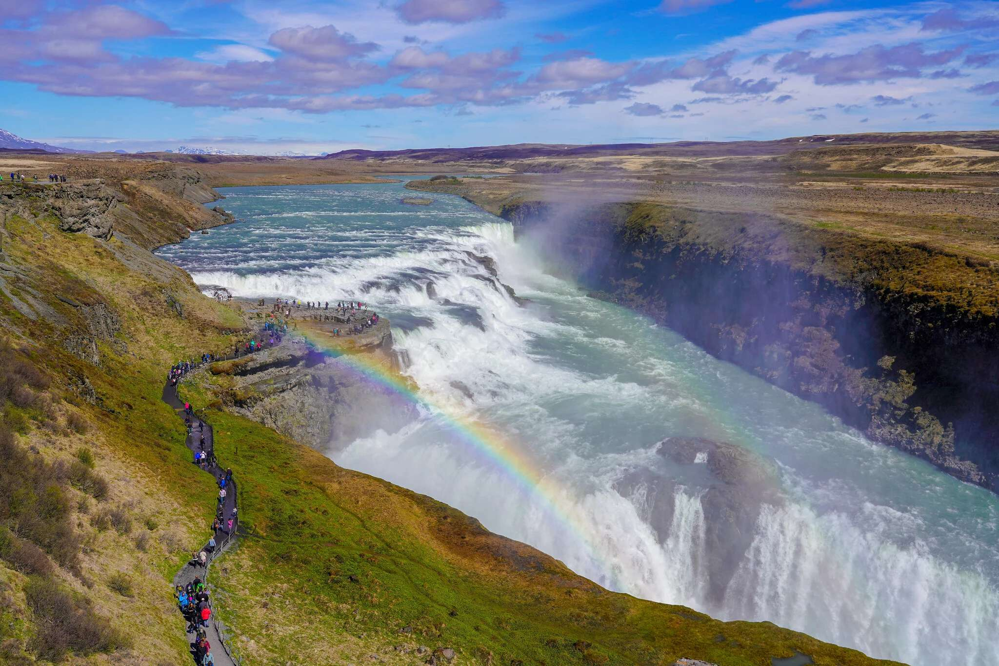 "Chasing waterfalls — and rainbows — at ""home"" in Iceland. Photo by Roberto Serrini."
