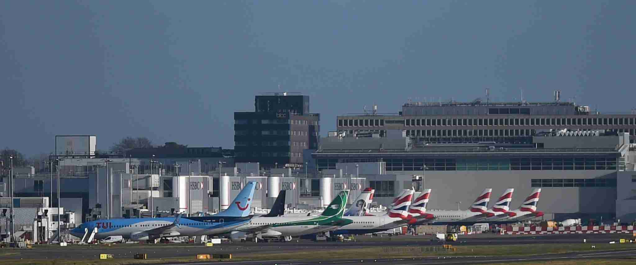Grounded aircraft next to a terminal at Gatwick airport which has been closed this morning after drones were spotted over the airfield last night and this morning. (Photo by Pete Summers/PA Images via Getty Images)