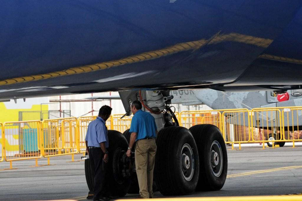 Boeing 787 landing gear and wheels being inspected. ROSLAN RAHMAN/AFP/Getty Images