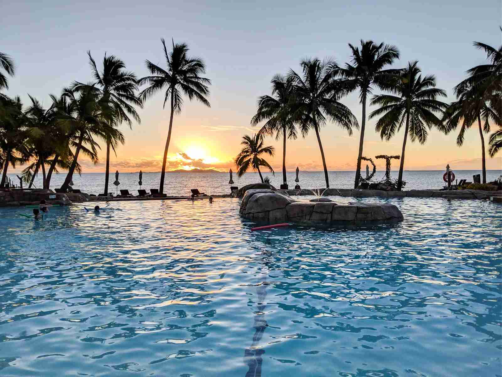 Hilton Doubletree Fiji pool sunset