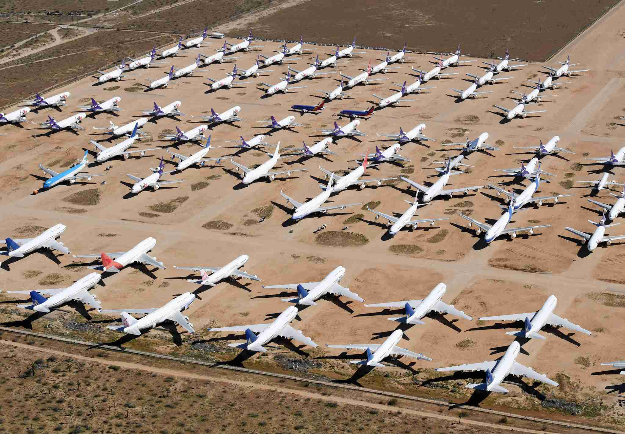 This photo taken on March 28, 2019 shows planes from various airlines in storage at a