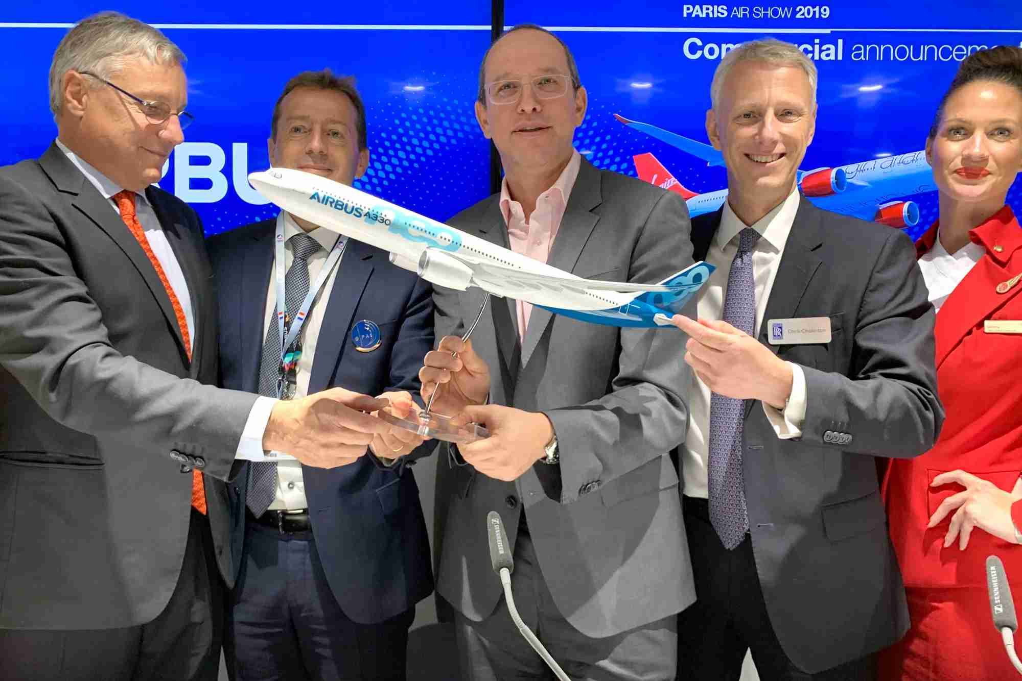 Airbus, Virgin Atlantic and Rolls-Royce executives announce an A330neo order at the 2019 Paris Air Show. Photo by Zach Honig / The Points Guy.