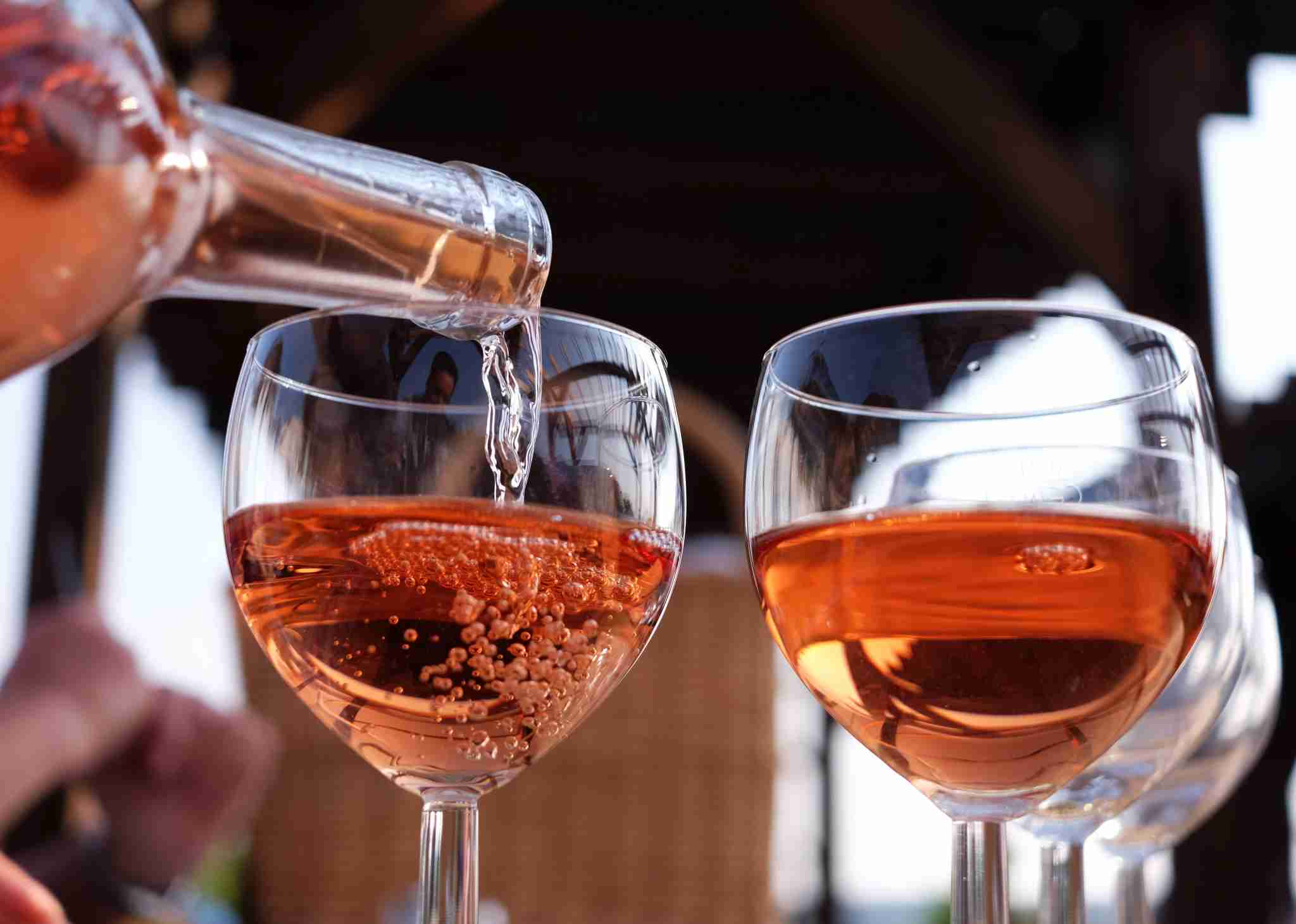 Rosé wine is poured into glasses at vineyard Klosterhof Toplitz in the sunshine in Toplitz, Germany, 10 September 2016. The ecologically managed vineyard has 2.5 hectars of land and a tavern selling homegrown vine. Pinot gris and pinot blanc, riesling and regent are cultivated here. Photo: Jens Kalaene/dpa   usage worldwide (Photo by Jens Kalaene/picture alliance via Getty Images)