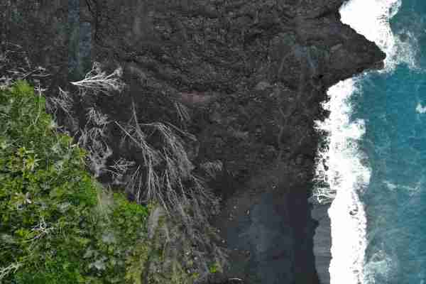 The 2018 eruption paved over 14 square miles of the Big Island, but also created some new black sand beaches like the one in the bottom of this picture.