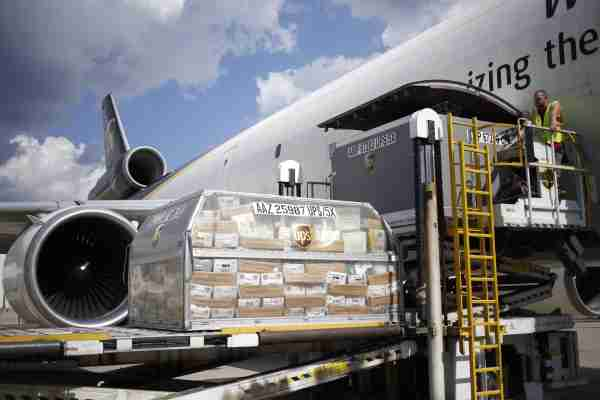 A shipping container of United States Postal Service (USPS) mail is loaded onto a cargo jet on the tarmac at the United Parcel Service Inc. (UPS) Worldport facility in Louisville, Kentucky, U.S., on Friday, Oct. 5, 2018. UPS is scheduled to release earnings figures on October 24. Photographer: Luke Sharrett/Bloomberg via Getty Images