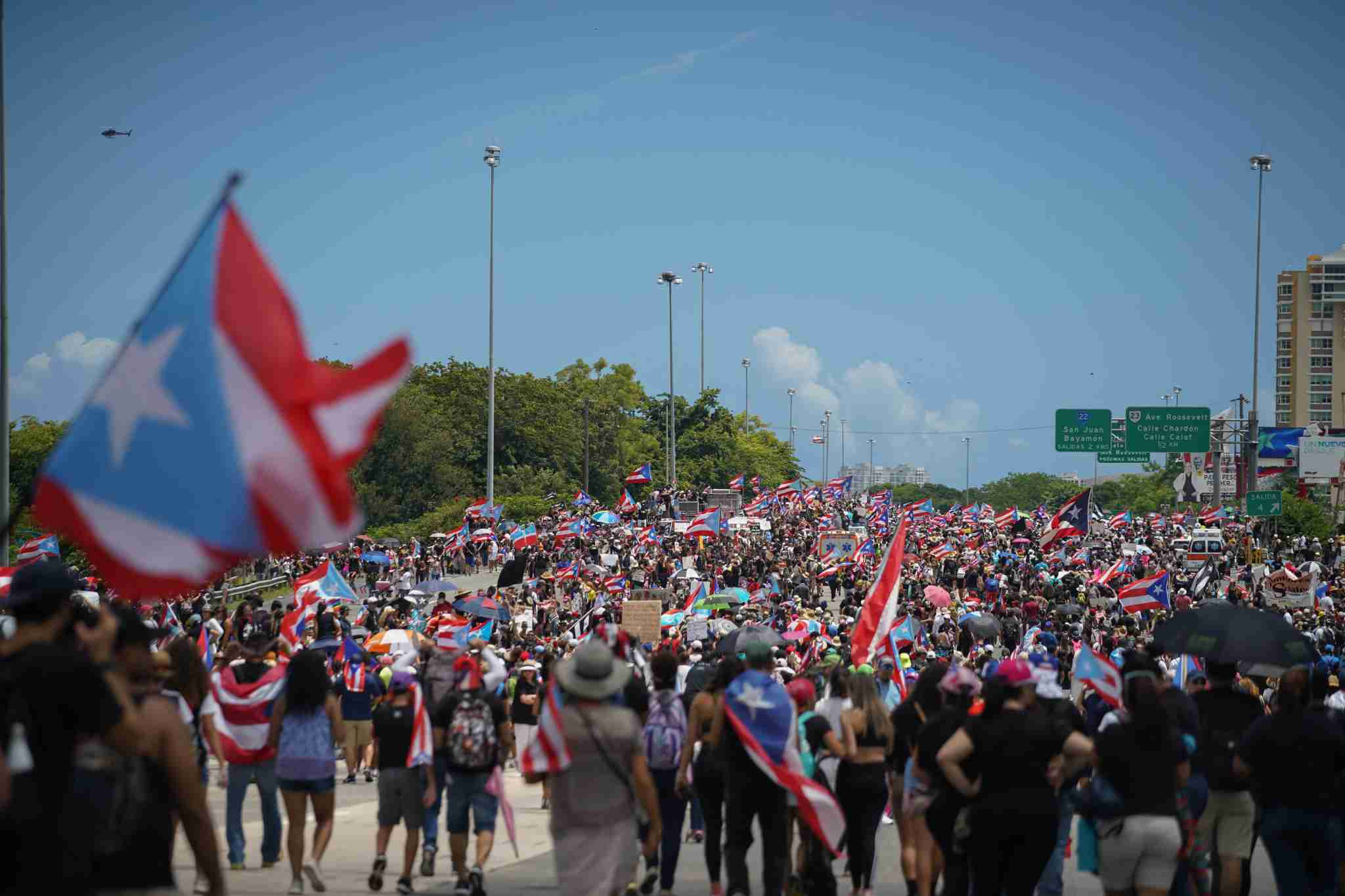 SAN JUAN, PUERTO RICO - JULY 22: Demonstrators walk down the Las Americas Expressway, the biggest highway in Puerto Rico as part of a massive march on July 22, 2019 in San Juan, Puerto Rico. There have been calls for the Governor to step down after it was revealed that he and top aides were part of a private chat group that contained among other messages misogynistic and homophobic messages. (Photo by Angel Valentin/Getty Images)