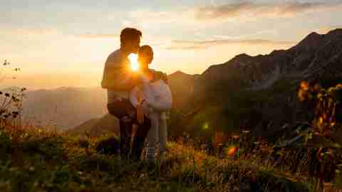 Family baby sunset mountains
