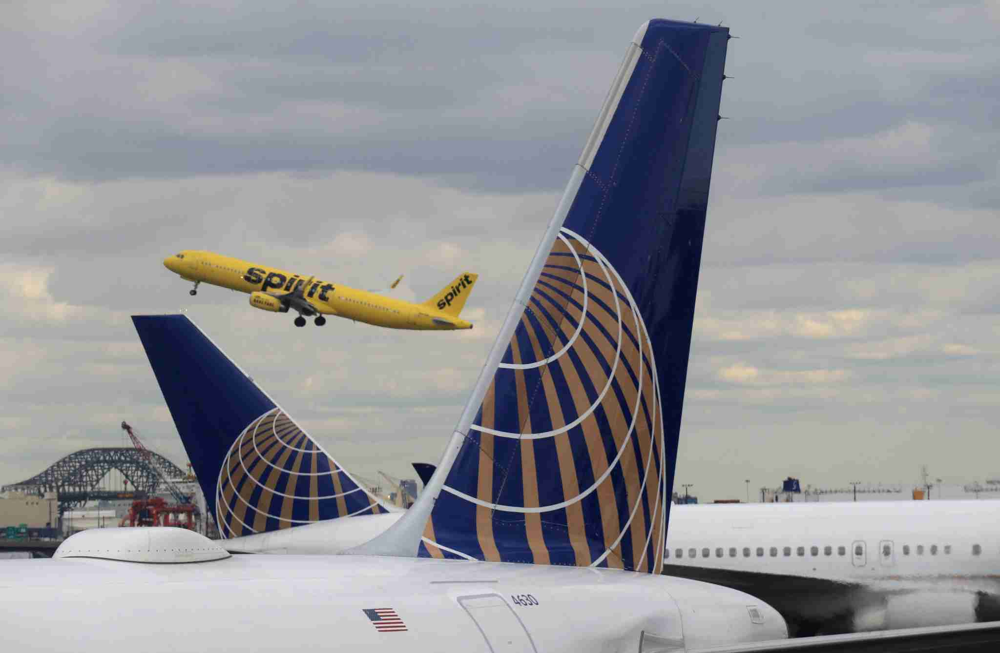NEWARK, NJ - MARCH 23: A Spirit Airlines jet takes off above two United Airlines airplanes at Newark Liberty Airport on March 23, 2018 in Newark, New Jersey. (Photo by Gary Hershorn/Getty Images)