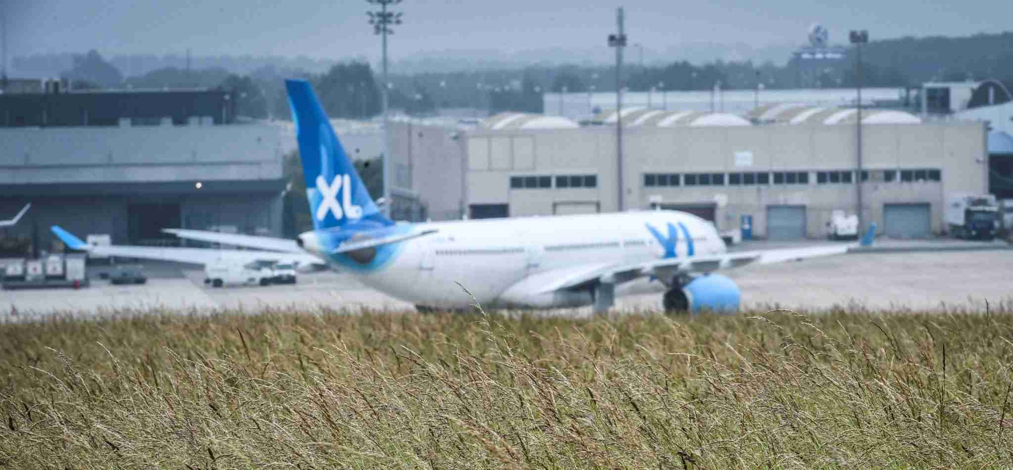 An XL Airways is seen from a distance at Paris Charles de Gualle Airport. (Photo credit Stephane de Sakutin / AFP/Getty Images)