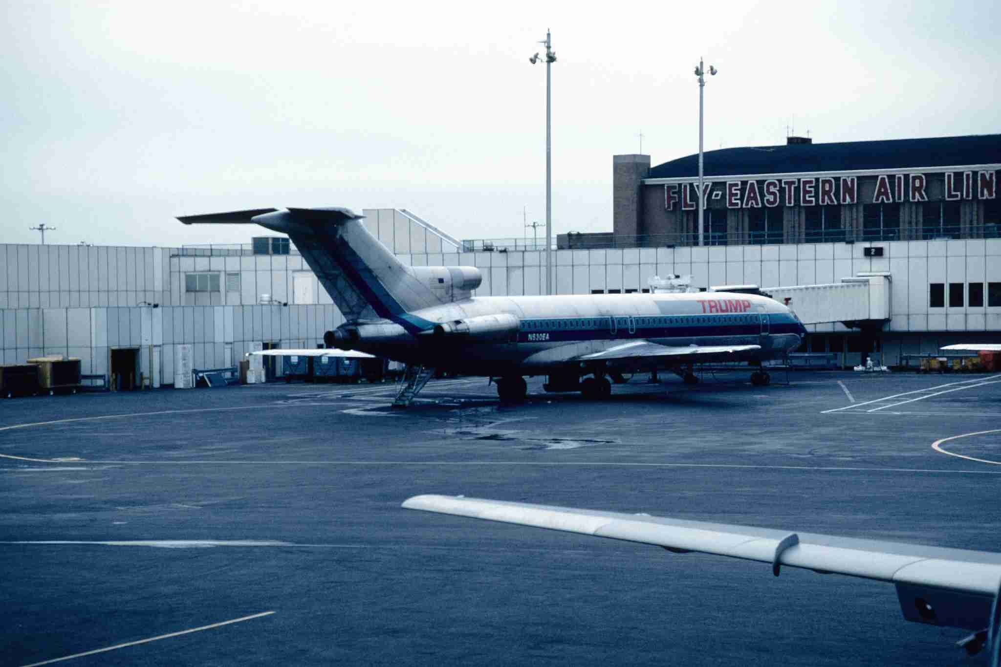 A Trump Shuttle Boeing 727 with the rear stairs deployed at New York LaGuardia. (Photo by FotoNoir/Wikimedia Commons)