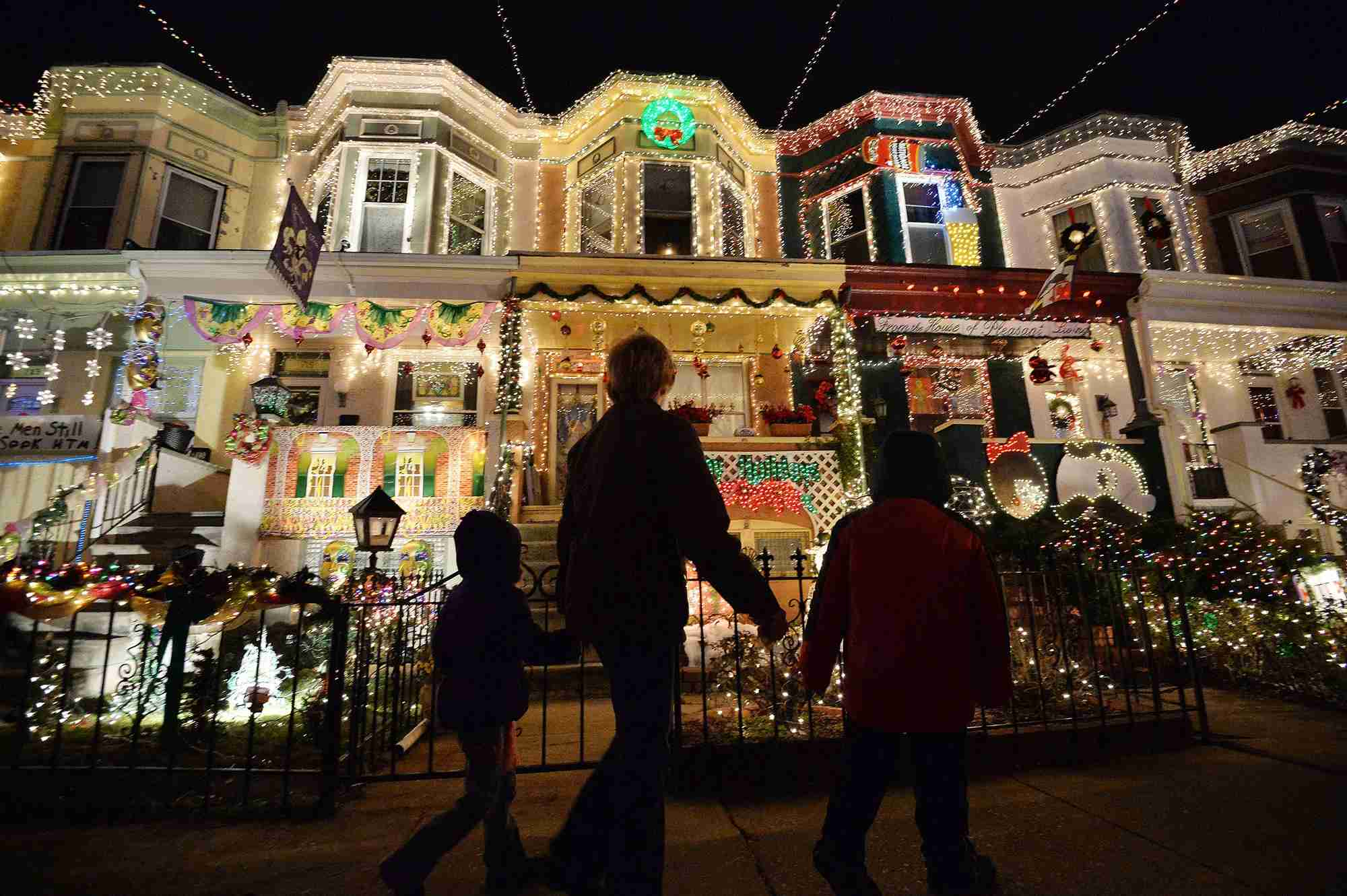 People enjoy the Christmas lights on the 700 block of 34th Street in the Hampden community of Baltimore (Photo by MLADEN ANTONOV/AFP via Getty Images)