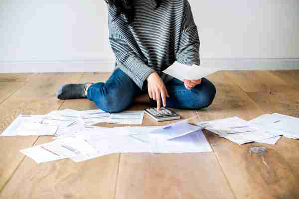 Woman managing the debt***These documents are our own generic designs. They do not infringe on any copyrighted designs. Photo by Rawpixel/Getty Images