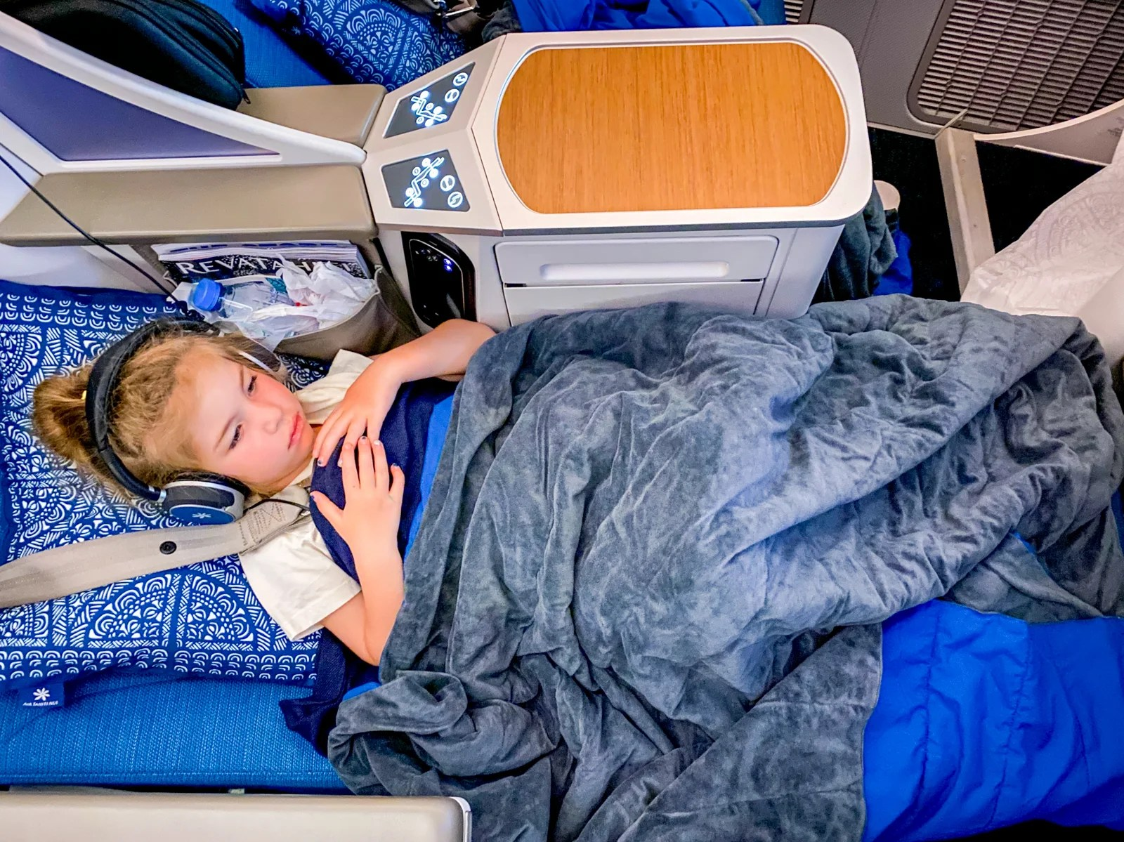 What it's really like flying business class with little kids