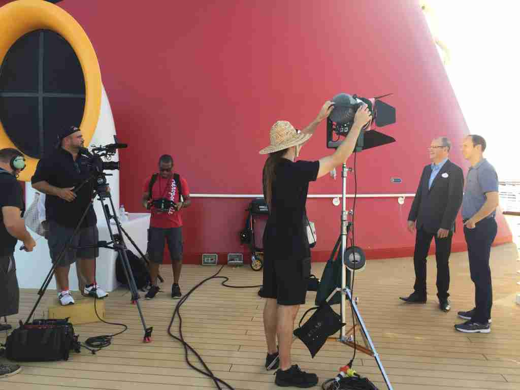 Gene Sloan interviewing Disney Cruise Line entertainment executive Jim Urry in 2016 aboard the Disney Wonder for a video series on the ship. (Photo courtesy of Gene Sloan)