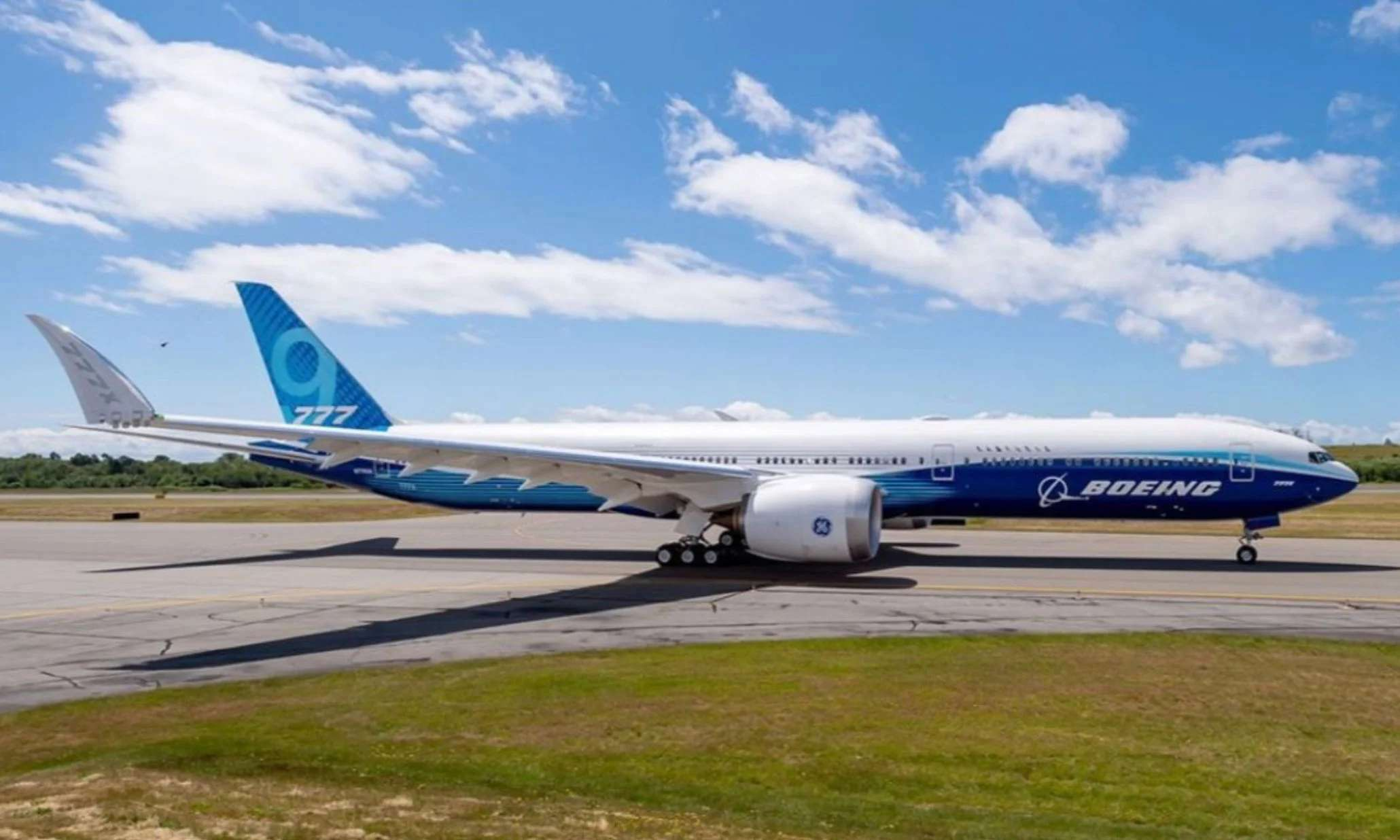 The Boeing 777X. The folded wingtips are lowered prior to takeoff to form a blended, raked wingtip. (Photo courtesy of Boeing)