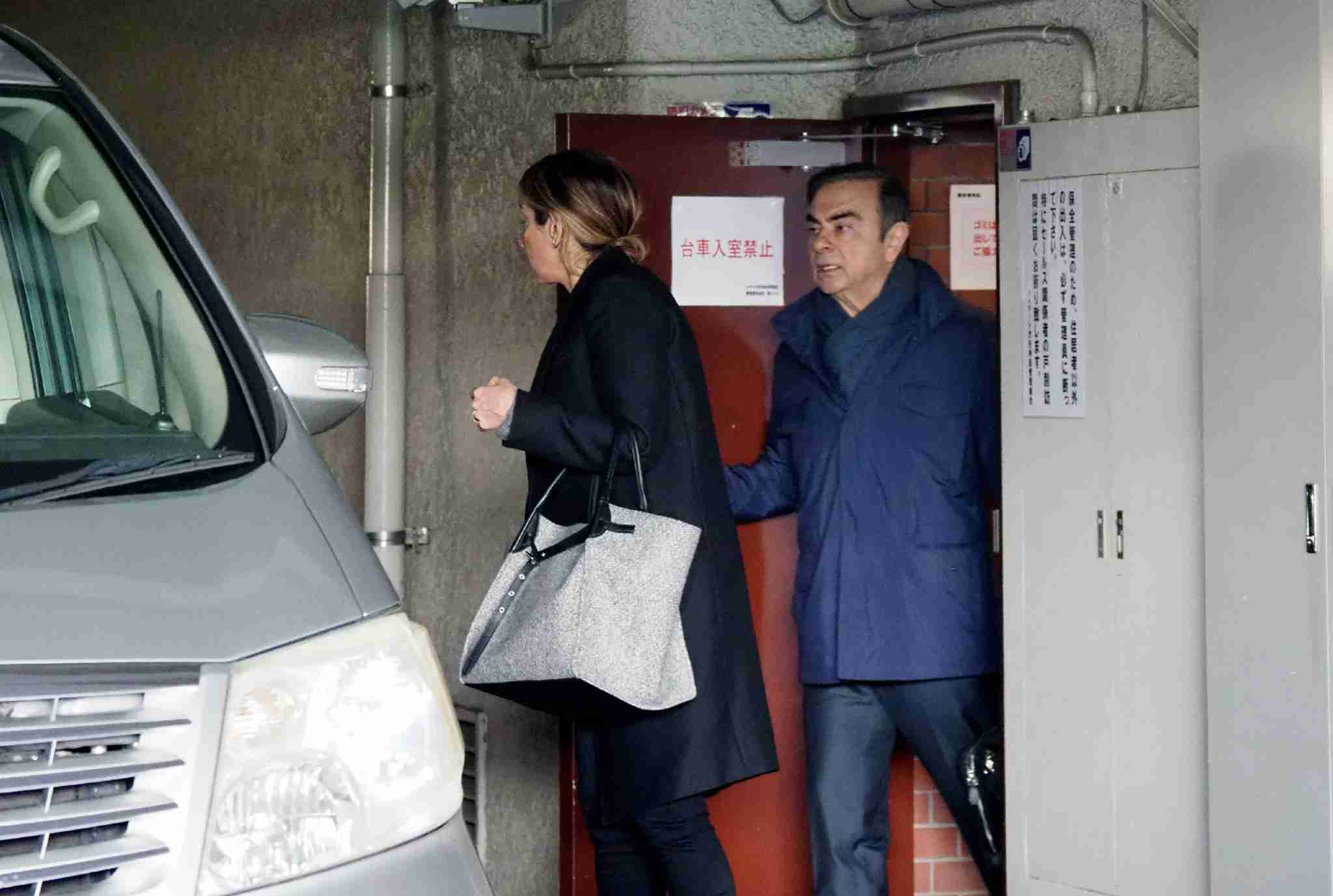 Former Nissan chairman Carlos Ghosn (R) leaves his residence in Tokyo on April 3, 2019. - Ghosn was freed from a Tokyo detention centre on March 6 after his shock arrest on November 19 when Japanese prosecutors stormed into his corporate jet. (Photo by JIJI PRESS / JIJI PRESS / AFP) / Japan OUT (Photo credit should read JIJI PRESS/AFP via Getty Images)