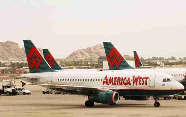 Phoenix, UNITED STATES:  America West jets are seen on the tarmac of the Phoenix Air Harbor airport in Phoenix, AZ, 27 September 2005. US Airways formally emerged from bankruptcy protection and completed a merger with low-cost carrier America West that creates the fifth largest US airline, the companies announced.    AFP PHOTO/Mandel NGAN  (Photo credit should read MANDEL NGAN/AFP via Getty Images)