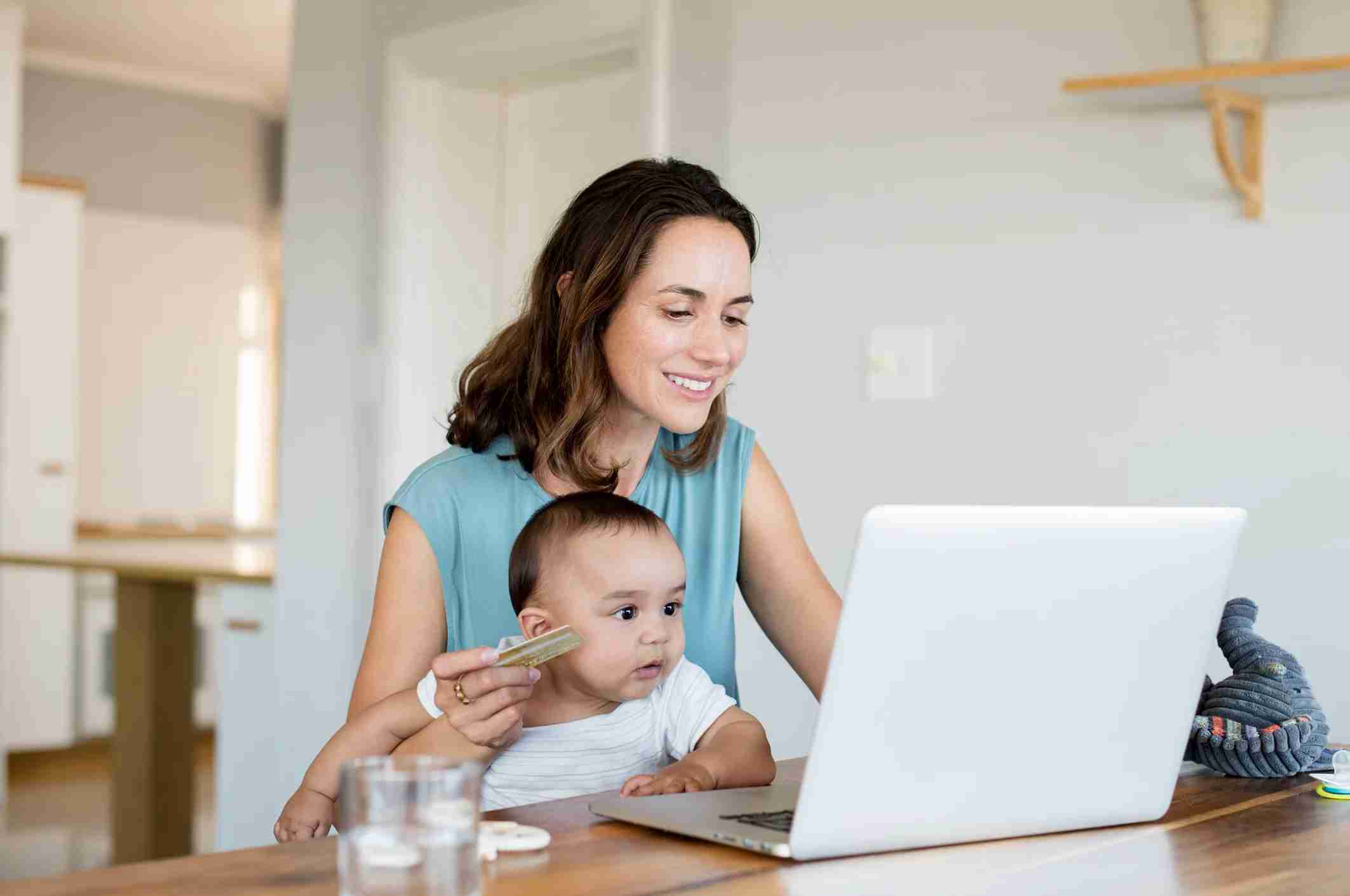 woman and baby with laptop and credit card