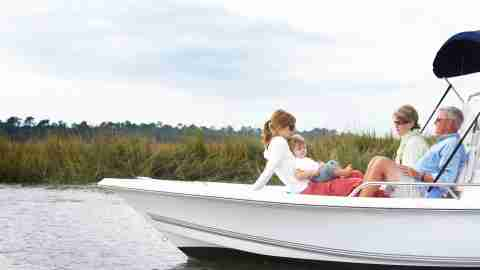 grandparents, mom and child boating